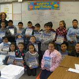 Monroe Elementary 3rd graders getting their dictionaries