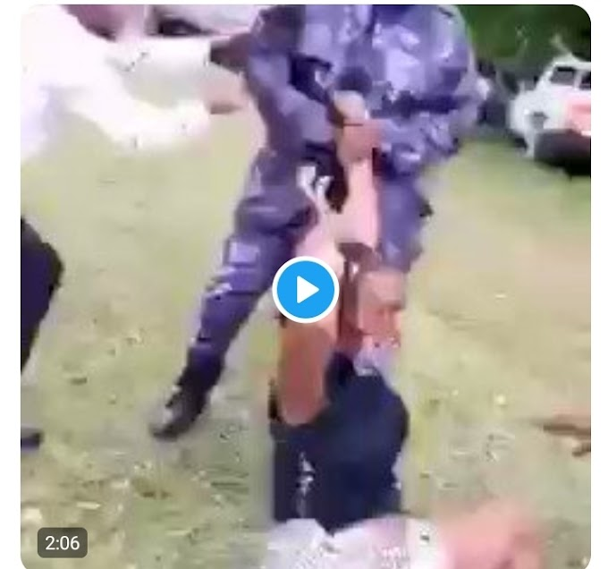 Breaking: Viral video of Uganda police officers caught molesting a lady in the presence of her child