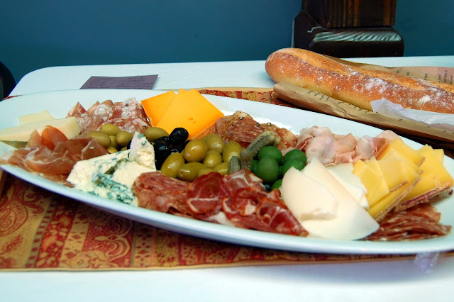 A tray of deli meats, cheeses, olives and a fresh Avenue Bread baguette as presented at Purple Space. / Credit: Bellingham Whatcom County Tourism