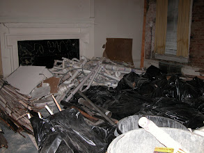 Photo: November 2003 - Month 3: Debris collectding in Room 111. Demolition of the interior took about 30 dumpsters!
