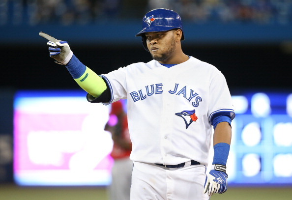 TORONTO, CANADA - MAY 12:  Juan Francisco #47 of the Toronto Blue Jays reacts after hitting a two-run single in the eighth inning during MLB game action against the Los Angeles Angels of Anaheim on May 12, 2014 at Rogers Centre in Toronto, Ontario, Canada. (Photo by Tom Szczerbowski/Getty Images)
