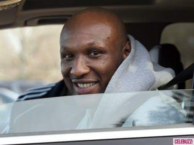 Lamar Odom smiling in car image