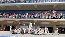 Jenson Button makes a pit stop