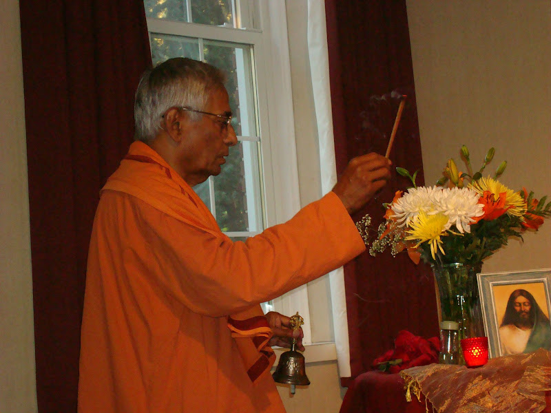 Swami Brahmarupananda conducts the evening prayer