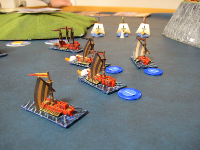 The Hell Hammers line up and deliver, two sinking the Wizard's Corsair and the third missing the center Buccaneer.