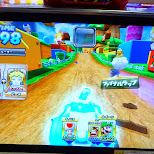 full speed with my friend Yuko playing MarioKart DX in Shibuya, Tokyo, Japan