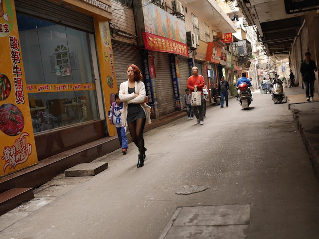 woman walking down Wuya Lane in Shaoguan, Guangdong