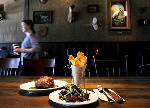Pork shank with parsley sauce, roast beet salad, housemad chips at Smith on Capitol Hill [Seattle Times, Alan Berner, 2008]