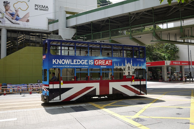 Hong Kong tram with advertising for Great Britain's universities