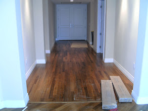 Photo: large hallway of leaving room installed with hardwood