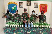 Satgas Pamtas RI-Malaysia Yonif 642/Kps Gagalkan Penyelundupan Ratusan Botol Minuman Keras