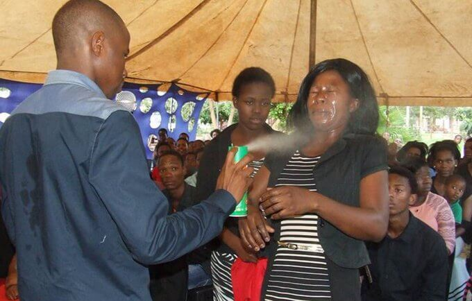 A pastor sprays doom to kick out devil. PHOTO | FILE