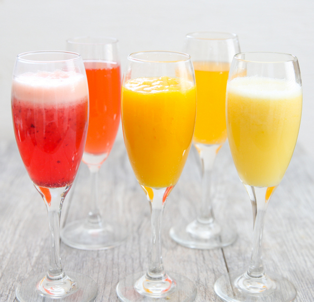 photo of glasses of Non-Alcoholic Mimosas lined up