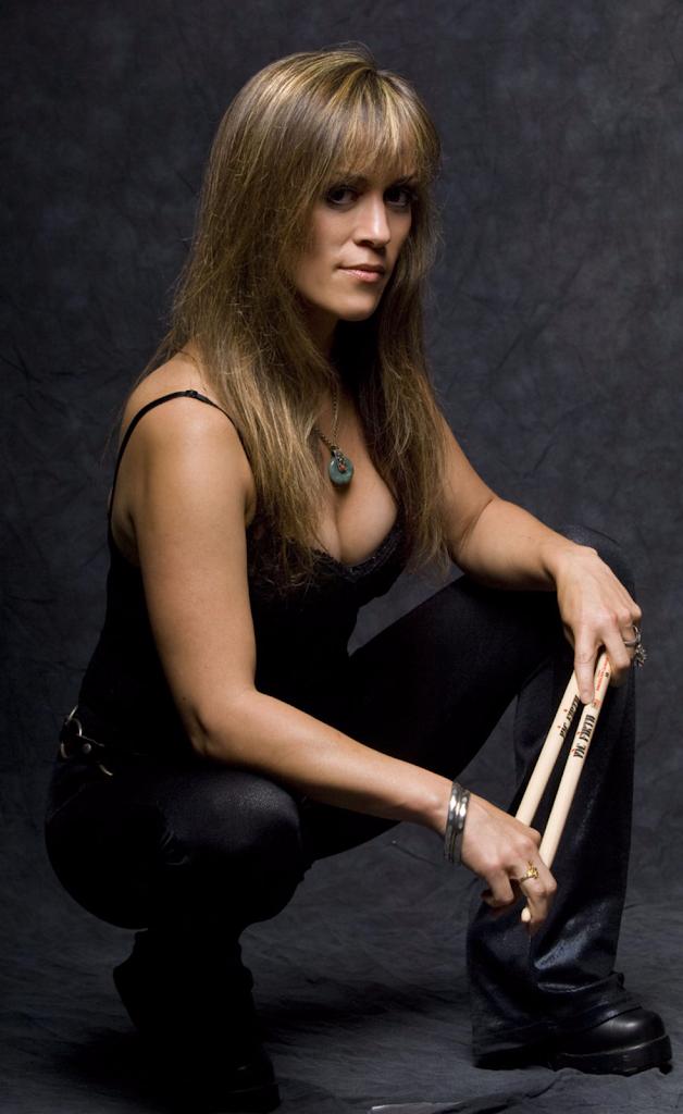 """Linda """"Nikki McBURRain"""" McDonald on drums.png"""