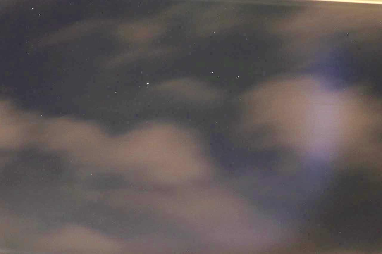 Trying to see Stars through the clouds in Tromsø, in this 10 second exposure (Source: Palmia Observatory)