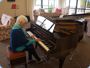 Audrey Henden playing the Schimmel grand piano