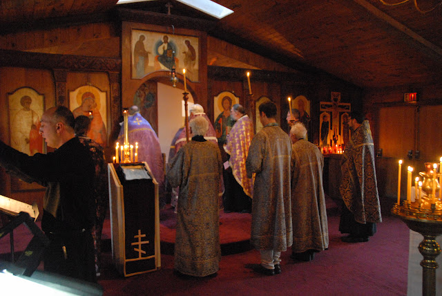 The clergy venerate the icons on the iconostasis before returning into the altar.