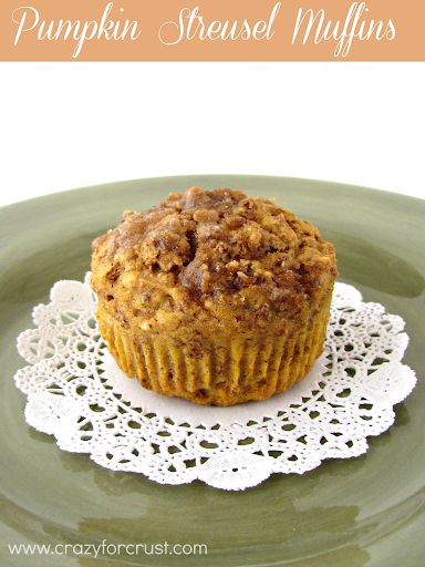 Pumpkin streusel muffin on a white doily on a green plate