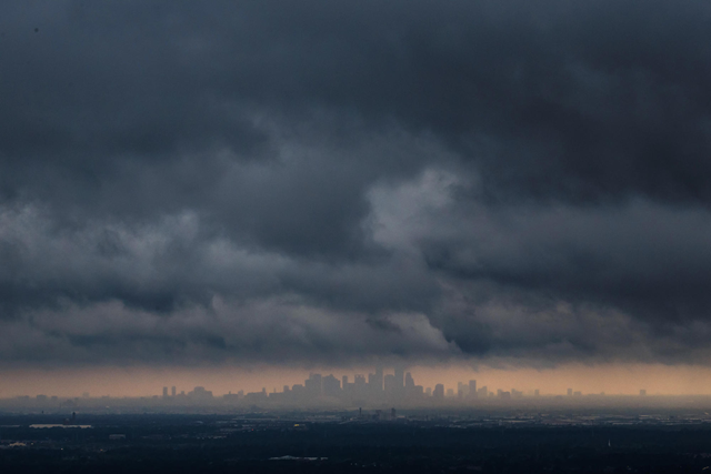 Storm clouds loom over the Houston skyline after the passage of Hurricane Harvey. Photo: Marcus Yam / Los Angeles Times