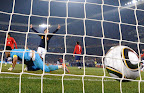 Chile's goalkeeper Claudio Bravo (L) misses a goal by Spain's midfielder Andres Iniesta during their Group H first round 2010 World Cup football match on June 25, 2010 at Loftus Verfeld stadium in Tshwane/Pretoria. NO PUSH TO MOBILE / MOBILE USE SOLELY WITHIN EDITORIAL ARTICLE  AFP PHOTO / VINCENZO PINTO