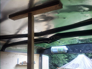 A look at the makeshift temporary support I had going on while I cut out the twisted roof bows.