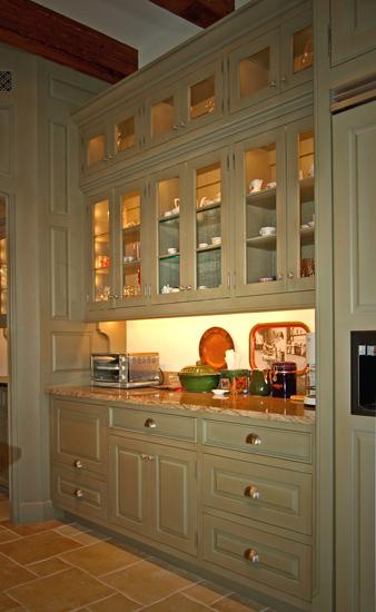 morgan creek designed this attractive green glazed pantry with lots of glass