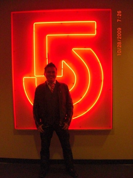 Asian Playboy In Front Of The Channel 5 Logo, Asian Playboy