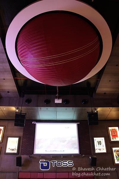 A huge cricket ball on the ceiling of Toss Sports Lounge Koregaon Park