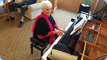 Audrey Henden playing the grand piano.