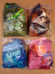 felt scraps organized by color in Ziplock bags