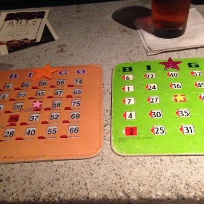 bingo cards and drink specials at drag queen bingo in new york city