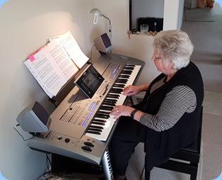 Our host, Barbara Powell, playing her Yamaha Tyros 5.