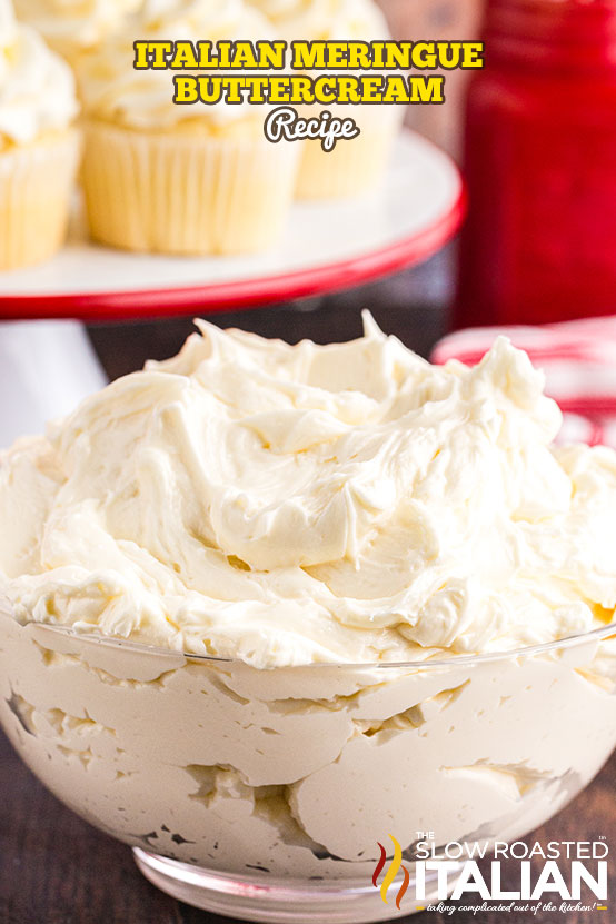 Italian Meringue Buttercream Recipe in a bowl with cupcakes in the background