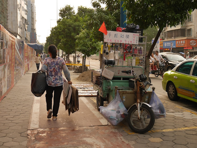 street vendor with a PRC flag in Zhongshan, China