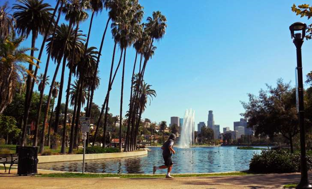 A man runs along the shore of Echo Park Lake just north of downtown Los Angeles on 12 March 2016. Photo: Reed Saxon / AP Photo