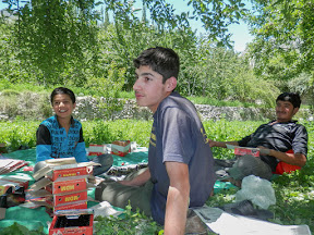Faiz Ahmed (L) with his friends packing cherries in Murtazabad.