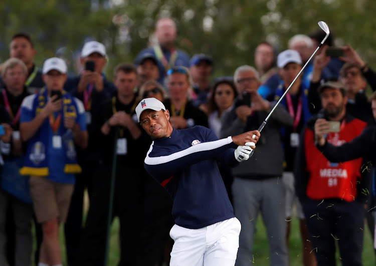 tiger woods tees off as americans chase rare european win