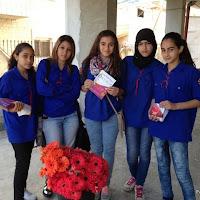 توزيع الورود للأمهات من الشبيبه العاملة والمتعلمة