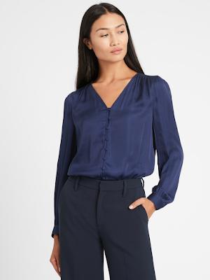 lady wearing an elegant navy satin blouse