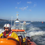 The ILB tows a broken down motorboat during the Bournemouth Air Show - 31 August 2014.   Photo: Poole RNLI