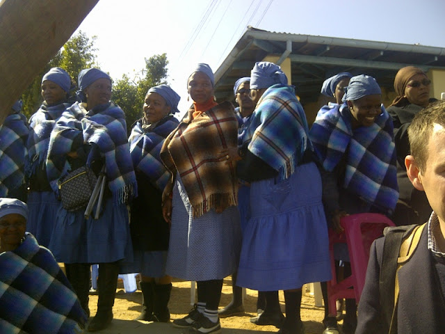 Blue shawls indicate they have been through Bojale