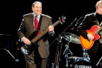 Mike Huckabee jamming on stage with band