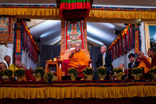 His Holiness the Dalia Lama with interpreter Thubten Jinpa, Kurukulla Center, Medford, Massachusetts, U.S., October 2012. Photo by Kadri Kurgun.