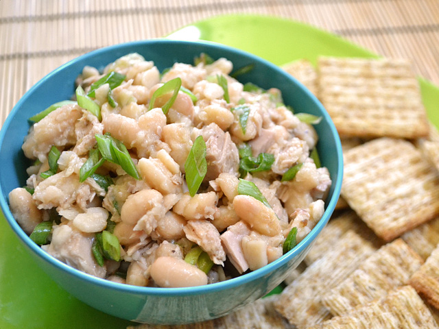Small bowl of tuna and white bean salad with crackers on the side