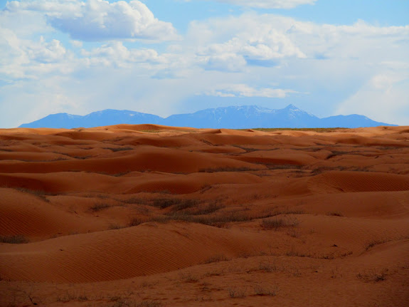 Sand dunes and Henry Mountains