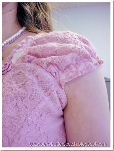 Short sleeves on a pretty pink dress.