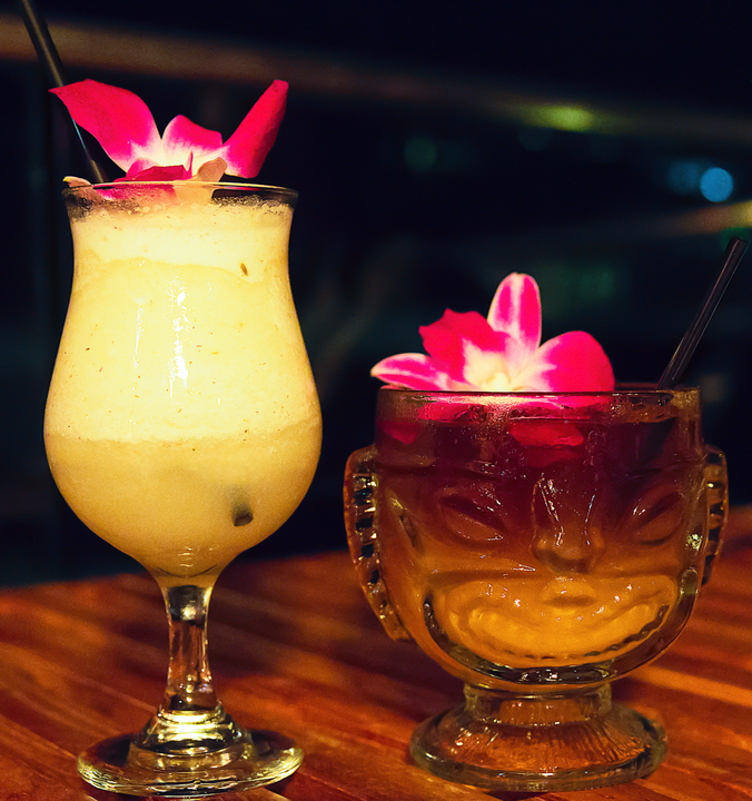 photo of glasses of Lavender Colada and Mai Tai
