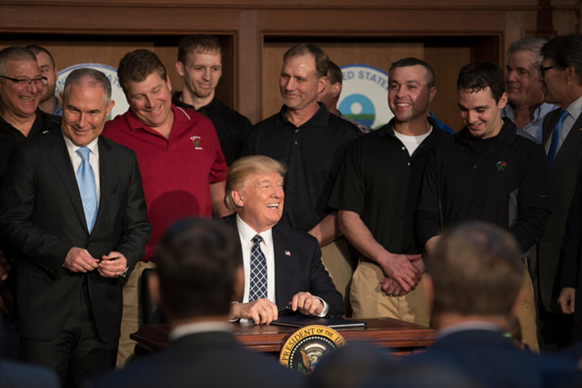 Scott Pruitt, left, administrator of the Environmental Protection Agency, with President Trump and a group of coal miners in March as the president signed an executive order that rolled back many climate-change policies. Photo: Stephen Crowley / The New York Times