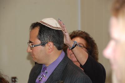 My Mum putting on my yarmulke.