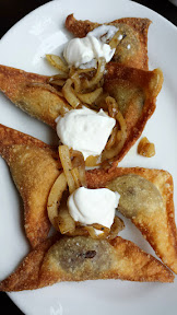 From Kenny and Zuke's for Dumpling Week are Fried kreplach, a traditional Jewish dumpling, filled with choice of beef or wild mushroom-leeks. They are served with sauteed onions and sour cream. You get six dumplings for the $8.75 price
